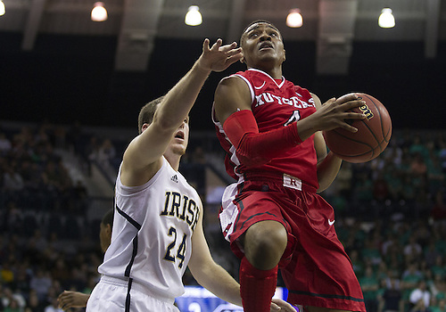 January 19, 2013:  Rutgers guard Myles Mack (4) goes up for a shot as Notre Dame guard Pat Connaughton (24) defends during NCAA Basketball game action between the Notre Dame Fighting Irish and the Rutgers Scarlett Knights at Purcell Pavilion at the Joyce Center in South Bend, Indiana.  Notre Dame defeated Rutgers 69-66.
