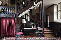 The substantial 16th century staircase, is carved with winged Welsh griffins and the hall carpet is by Asad
