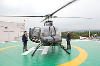 Architects Norman Foster and Fernando Romero during a helicopter ride to Toluca airport from the Camino Real hotel, Mexico City.