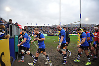 Bath Rugby players make their way to the changing rooms at the end of the pre-match warm-up. Aviva Premiership match, between Bath Rugby and Worcester Warriors on December 27, 2015 at the Recreation Ground in Bath, England. Photo by: Patrick Khachfe / Onside Images