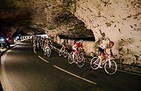 riders rolling through a spectacular huge/dark cave: the 'Grotte du Mas-d'Azil'<br /> <br /> Stage 16: Carcassonne &gt; Bagn&egrave;res-de-Luchon (218km)<br /> <br /> 105th Tour de France 2018<br /> &copy;kramon