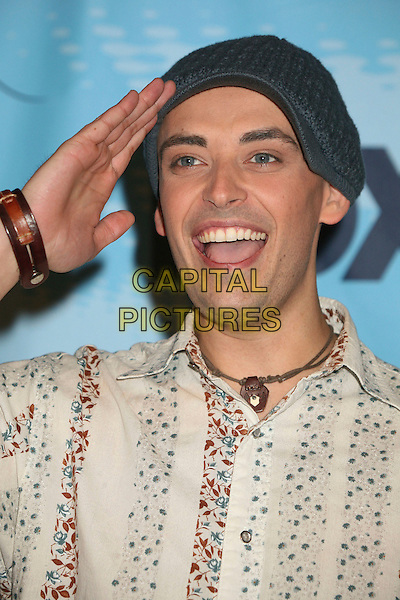 "PHIL STACEY.""American Idol"" Season 6 Top 12 Finalists Party at Astra West/Pacific Design Center, West Hollywood, California, USA, 8 March 2007..portrait headshot hand touching head salute hat.CAP/ADM/BP.©Byron Purvis/AdMedia/Capital Pictures."