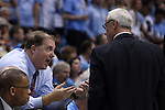 18 January 2015: UNC senior associate athletic director Steve Kirschner (left) explains a call to head coach Roy Williams (right) during a timeout. The University of North Carolina Tar Heels played the Virginia Tech University Hokies in an NCAA Division I Men's basketball game at the Dean E. Smith Center in Chapel Hill, North Carolina. UNC won the game 68-53.