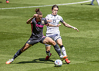 Leeds United's Kalvin Phillips competing with Swansea City's Conor Gallagher (right) <br /> <br /> Photographer Andrew Kearns/CameraSport<br /> <br /> The EFL Sky Bet Championship - Swansea City v Leeds United - Sunday 12th July 2020 - Liberty Stadium - Swansea<br /> <br /> World Copyright © 2020 CameraSport. All rights reserved. 43 Linden Ave. Countesthorpe. Leicester. England. LE8 5PG - Tel: +44 (0) 116 277 4147 - admin@camerasport.com - www.camerasport.com