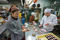 Japan, Ishikawa, Yamanaka. Family run Sankaido Confectionary Shop, since 1900, for five generations. Although this was usually a male run business the father is happy to see his daughter, 28, learn the fine art of confectionary from him. She studied business in the United States and came back to work here with her family. Model released