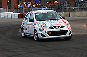 Nissan Micra Cup race with Elvis Stojko at the wheel of a Nissan Micra in turn number 9