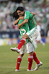 June 08 2008:  Francisco Arce (Santos Laguna) (15) of Mexico celebrates his goal with teammate Ricardo Osorio (VFB Stuttgart / GER) (5).  During the third and final match of Mexico's 2008 USA Tour in preparation for qualification for FIFA's 2010 World Cup, the national soccer team of Mexico defeated Peru 4-0 at Soldier Field, in Chicago, IL.