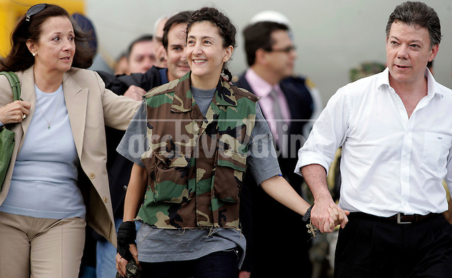 Former hostage Ingrid Betancourt with her mother, Yolanda Pulecio, and Colombian Defense Minister Juan Carlos Santos,  upon her arrival to Bogota after being rescued from leftist guerrillas FARC that hold her captive during 6 years..