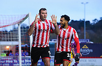 Lincoln City's Matt Rhead celebrates scoring the opening goal with team-mate Matt Green<br /> <br /> Photographer Chris Vaughan/CameraSport<br /> <br /> The Emirates FA Cup Second Round - Lincoln City v Carlisle United - Saturday 1st December 2018 - Sincil Bank - Lincoln<br />  <br /> World Copyright © 2018 CameraSport. All rights reserved. 43 Linden Ave. Countesthorpe. Leicester. England. LE8 5PG - Tel: +44 (0) 116 277 4147 - admin@camerasport.com - www.camerasport.com