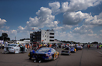 Aug. 16, 2013; Brainerd, MN, USA: NHRA comp eliminator cars lined up in the staging lanes during qualifying for the Lucas Oil Nationals at Brainerd International Raceway. Mandatory Credit: Mark J. Rebilas-