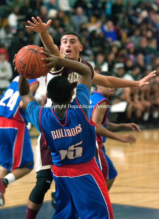WATERBURY,  CT, 10 DECEMBER 2011-121011JS19-Sacred Hearts' Eddie Rivera (13) puts pressure on Crosby's Trevon Butler during their game in the boys city basketball jamboree Saturday at Kennedy High School. <br /> Jim Shannon Republican-American