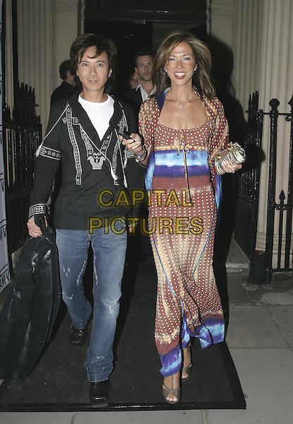 ANDY WONG & GUEST.MAC VIVA GLAM V - Launch Party.Home House, London W1.April 21st, 2005.full length jeans denim black top brown blue sumery dress.www.capitalpictures.com.sales@capitalpictures.com.© Capital Pictures.