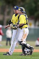 February 22, 2009:  Pitcher Mike Dufek (7) and catcher Chris Berset (10) of the University of Michigan during the Big East-Big Ten Challenge at Naimoli Complex in St. Petersburg, FL.  Photo by:  Mike Janes/Four Seam Images