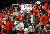 Fans hold up signs as Virginia defeated Syracuse 75-56 in an NCAA basketball game Saturday March 1, 2014 in Charlottesville, VA.