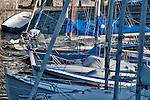 Boats docked at the Gravedona, a town on Lake Como, Italy