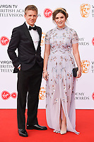 George Rainsford and Chelsea Halfpenny arriving for the BAFTA TV Awards 2018 at the Royal Festival Hall, London, UK. <br /> 13 May  2018<br /> Picture: Steve Vas/Featureflash/SilverHub 0208 004 5359 sales@silverhubmedia.com