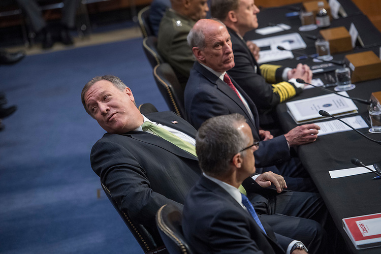 "UNITED STATES - MAY 11: CIA Director Mike Pompeo, left, speaks with an aide during a Senate (Select) Intelligence Committee hearing in Hart Building titled ""World Wide Threats"" on May 11, 2017. Also appearing, from bottom, acting FBI Director Andrew McCabe, Director of National Intelligence Daniel Coats, National Security Agency Director Adm. Mike Rogers, and Defense Intelligence Agency Director Lt. Gen. Vincent Stewart. (Photo By Tom Williams/CQ Roll Call)"