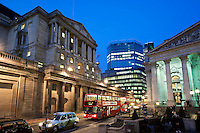 United Kingdom, England, London: Bank of England (on left) and Royal Exchange (on right) in The City financial district at night