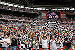 Swansea fans cheering  their team on to the pitch before the Npower Championship play-off final between Reading (blue) and Swansea City at Wembley Stadium. The match was won by Swansea by 4 goals to 2 watched by a crowd of 86,581. Swansea became the first Welsh team to reach the top division of English football since they themselves played there in 1983.