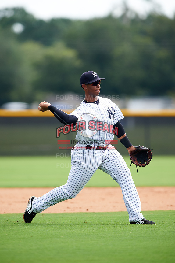 GCL Yankees East third baseman Lisandro Blanco (14) throws to first base during the first game of a doubleheader against the GCL Yankees West on July 19, 2017 at the Yankees Minor League Complex in Tampa, Florida.  GCL Yankees West defeated the GCL Yankees East 11-2.  (Mike Janes/Four Seam Images)