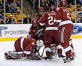 Kyle Richter (Harvard University - Calgary, AB) looks to cover the puck with help from Kevin Du (Harvard University - Spruce Grove, AB), NAME, JD McCabe (Harvard University - Jamison, PA) and Jack Christian (Harvard University - Wilton, CT). The Boston College Eagles defeated the Harvard University Crimson 3-1 in the first round of the 2007 Beanpot Tournament on Monday, February 5, 2007, at the TD Banknorth Garden in Boston, Massachusetts.  The first Beanpot Tournament was played in December 1952 with the scheduling moved to the first two Mondays of February in its sixth year.  The tournament is played between Boston College, Boston University, Harvard University and Northeastern University with the first round matchups alternating each year.