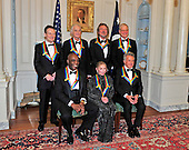 The seven recipients of the 2012 Kennedy Center Honors pose for a photo following a dinner hosted by United States Secretary of State Hillary Rodham Clinton at the U.S. Department of State in Washington, D.C. on Saturday, December 1, 2012.  The 2012 honorees are Buddy Guy, actor Dustin Hoffman, late-night host David Letterman, dancer Natalia Makarova, and the British rock band Led Zeppelin (Robert Plant, Jimmy Page, and John Paul Jones).   From left to right, back row: John Paul Jones, Jimmy Page, Robert Plant, and David Letterman.  From left to right, front row: Buddy Guy, Natalia Makarova, and Dustin Hoffman..Credit: Ron Sachs / CNP