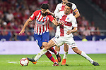 Diego Costa of Atletico Madrid and Musto of SD Huesca during the match between Atletico Madrid v SD Huesca of LaLiga, 2018-2019 season, date 6. Wanda Metropolitano Stadium. Madrid, Spain - 25 September 2018. Mandatory credit: Ana Marcos / PRESSINPHOTO