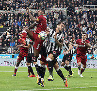 Liverpool's Georginio Wijnaldum with an early attempt on goal under pressure from Newcastle United's Joselu<br /> <br /> Photographer Rich Linley/CameraSport<br /> <br /> The Premier League -  Newcastle United v Liverpool - Sunday 1st October 2017 - St James' Park - Newcastle<br /> <br /> World Copyright &copy; 2017 CameraSport. All rights reserved. 43 Linden Ave. Countesthorpe. Leicester. England. LE8 5PG - Tel: +44 (0) 116 277 4147 - admin@camerasport.com - www.camerasport.com