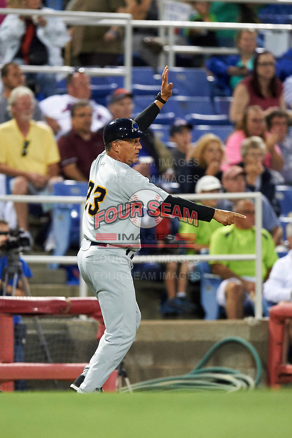 Trenton Thunder manager Al Pedrique (23) directs Tyler Austin (not shown) running the bases during a game against the Binghamton Mets on August 8, 2015 at NYSEG Stadium in Binghamton, New York.  Trenton defeated Binghamton 4-2.  (Mike Janes/Four Seam Images)