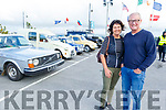Gemma and Jim Hannon from Listowel standing by the vintage cars at the Blennerville Trashing Festival on Sunday.