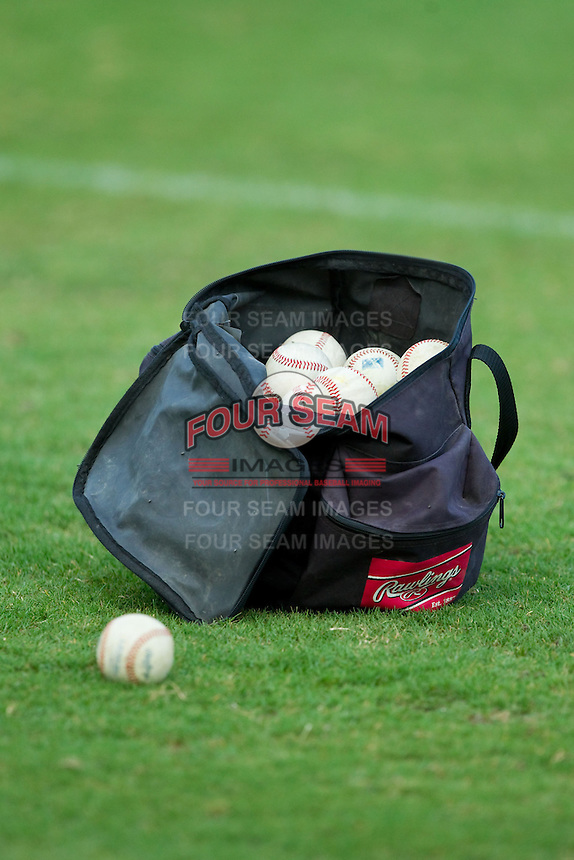 A bag of Rawlings baseballs sits on the field prior to the Carolina League game between the Lynchburg Hillcats and the Winston-Salem Dash at BB&T Ballpark on August 5, 2013 in Winston-Salem, North Carolina.  The Dash defeated the Hillcats 5-0.  (Brian Westerholt/Four Seam Images)