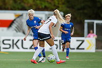 Seattle, Washington -  Sunday, September 11 2016: Seattle Reign FC forward Megan Rapinoe (15) looks for a pass during a regular season National Women's Soccer League (NWSL) match between the Seattle Reign FC and the Washington Spirit at Memorial Stadium. Seattle won 2-0.