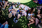 Music fans rest at Weekend 1 of the Coachella Valley Music and Arts Festival in Indio, California April 10, 2015. (Photo by Kendrick Brinson)