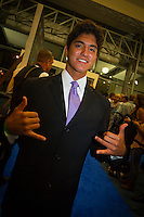 GOLD COAST, Queensland/Australia (Friday, February 24, 2012) Gabriel Medina (BRA).  The 29th Annual ASP World Surfing Awards went off tonight at the Gold Coast Convention and Exhibition Centre with the worlds best surfers trading the beachwear for formal attire as the 2011 ASP World Champions were officially crowned.. .Kelly Slater (USA), 40, and Carissa Moore (HAW), 19, took top honours for the evening, collecting the ASP World Title and ASP Womens World Title respectively.. .I have actually been on tour longer than some of my fellow competitors have been alive, Slater said. All joking aside, its truly humbling to be up here and honoured in front of such an incredible collection of surfers. I want to thank everyone in the room for pushing me to where I am...In addition to honouring the 2011 ASP World Champions, the ASP World Surfing Awards included new accolades voted on by the fans and the surfers themselves...For the first time in several years, ASP Life Membership was awarded to Hawaiian legend and icon of high-performance surfing, Larry Bertlemann (HAW), 56...Where surfing is today is where I dreamed it should be in the 70s, Bertlemann said. You guys absolutely deserve this and Im so honored to be up here in front of you all tonight..Grammy Award-winning artists Wolfmother and The Vernons rounded out the nights entertainment which was all streamed LIVE around the world on YouTube.com..Photo: joliphotos.com