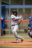 GCL Marlins shortstop Osiris Johnson (9) follows through on a swing during a game against the GCL Mets on August 3, 2018 at St. Lucie Sports Complex in Port St. Lucie, Florida.  GCL Mets defeated GCL Marlins 3-2.  (Mike Janes/Four Seam Images)