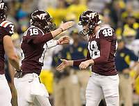 Justin Myer of Virginia Tech celebrates with Trey Gresh of Virginia Tech after Myer scored a field goal during Sugar Bowl game at Mercedes-Benz SuperDome in New Orleans, Louisiana on January 3rd, 2012.  Michigan defeated Virginia Tech, 23-20 in first overtime.