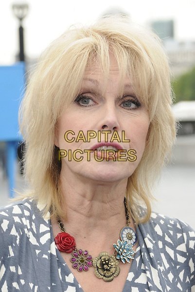 JOANNA LUMLEY  .The launch of the old furniture recycling scheme, The Scoop, More London, the Queen's Walk, London, England..July 12th, 2010.headshot portrait mouth open necklace flowers floral grey gray white print  .CAP/CAN.©Can Nguyen/Capital Pictures.