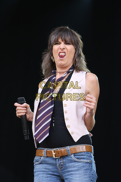 THE PRETENDERS - Chrissie Hynde.Perform during Hard Rock Calling 2009, Hyde Park, London, England, UK,27th June 2009..music concert gig on stage live festival .half length black top white waistcoat striped stripes tie purple hands tongue funny face.CAP/MAR.©Martin Harris/Capital Pictures