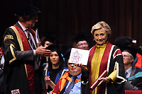 Pictured: Hillary Clinton (R) is handed a commemorative book about her family history at Swansea University Bay Campus. Saturday 14 October 2017<br />