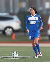 Boston Breakers midfielder Jo Dragotta (25) brings the ball forward.  In a National Women's Soccer League Elite (NWSL) match, the Boston Breakers (blue) tied the Washington Spirit (white), 1-1, at Dilboy Stadium on April 14, 2012.