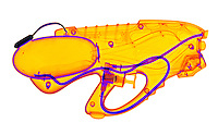 An X-ray of a squirt gun. This gun shoots water out the front when the trigger is pulled. This is a false color x-ray.