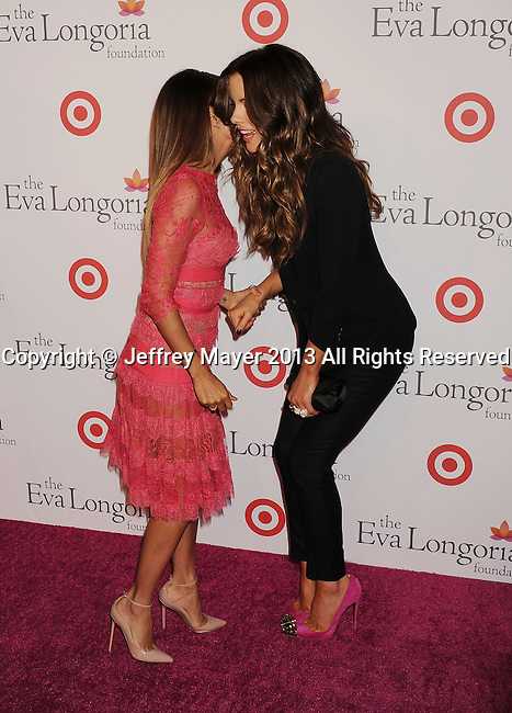 HOLLYWOOD, CA- SEPTEMBER 28: Actresses Eva Longoria and Kate Beckinsale arrive at the Eva Longoria Foundation Dinner at Beso restaurant on September 28, 2013 in Hollywood, California.