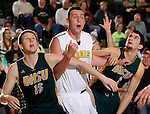 JANUARY 30, 2015 -- Chris Snyder #42 of Regis University battles for rebounding position between Collin Smith #15 and Nick Ongarato #2 of Black Hills State during their Rocky Mountain Athletic Conference men's basketball game Friday evening at the Donald E. Young Center in Spearfish, S.D.  (Photo by Dick Carlson/Inertia)
