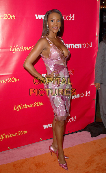 VIVICA A. FOX.Attend Lifetime Television's 5th Annual Women Rock! Concert for the fight against breast cancer held at The Wiltern Theatre in Los Angeles, California, USA, September 28 2004..full length womenrock pink swirly patterned sequined beaded dress hands on hips boobs cleavage low cut plunging neckline stilettoes shoes.Ref: DVS.www.capitalpictures.com.sales@capitalpictures.com.©Debbie VanStory/Capital Pictures .