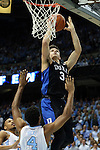 17 February 2016: Duke's Grayson Allen (3) shoots over North Carolina's Isaiah Hicks (4) and Nate Britt (left). The University of North Carolina Tar Heels hosted the Duke University Blue Devils at the Dean E. Smith Center in Chapel Hill, North Carolina in a 2015-16 NCAA Division I Men's Basketball game.