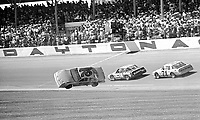 Phil Barkdoll crashes during a qualifying race for the Daytona 500, Daytona International Speedway, Daytona Beach, Florida, February 12, 1987. (Photo by Brian Cleary/www.bcpix.com)