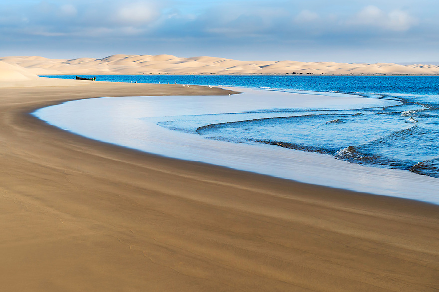 Lac Naila - Sahara desert sand dunes at the Atlantic coast, Morocco.