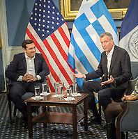 Greek Prime Minister Alexis Tsipras, left in New York City Hall at a meeting with New York Mayor Bill de Blasio on Thursday, October 1, 2015. The PM and the Mayor exchanged pleasantries during a brief photo op for the press. The International Monetary Fund has been criticized for promoting its punishing austerity programs related to Greece's massive debt and weak economy.   (© Richard B. Levine)