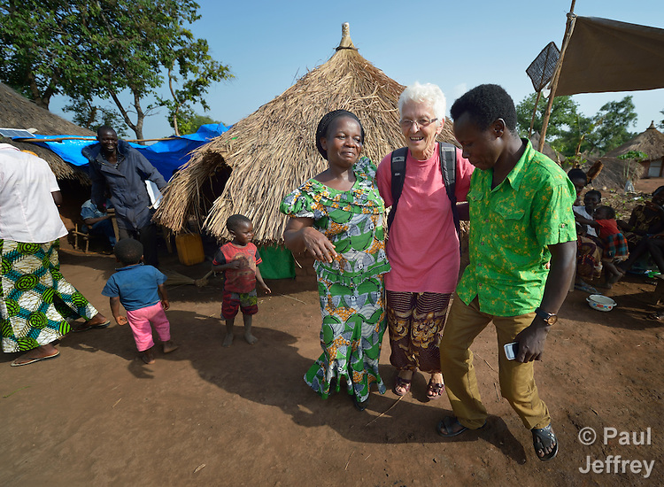 Sister Celine Tremblay, a Canadian member of the Daughters of Providence, dances with refugees celebrating the birth of a child in the Makpandu refugee camp, a ramshackle collection of huts with mud walls and thatched roofs spread through a remote section of forest 40 kilometers from Yambio, the capital of Western Equatoria State in South Sudan. As many as 3,000 people live in the camp, having fled the Democratic Republic of the Congo in 2008 when the Lord's Resistance Army started a murderous rampage through the area. Sister Tremblay works in the camp as a member of Solidarity with South Sudan, a pastoral and teaching presence of Catholic priests, sisters and brothers from around the world.
