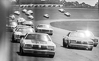 Cale Yarborough, #11 Oldsmobile, leads a pack of cars en route to 2nd place finish, 1978 Firecracker 400 NASCAR race, Daytona International Speedway, Daytona Beach, FL, July 4, 1978.  (Photo by Brian Cleary/ www.bcpix.com )
